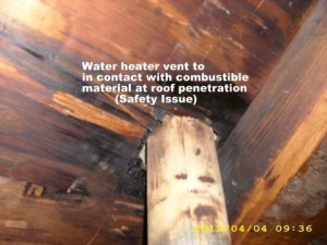 Home Inspection photo, furnace vent touching combustible material at roof, Natchitoches, LA